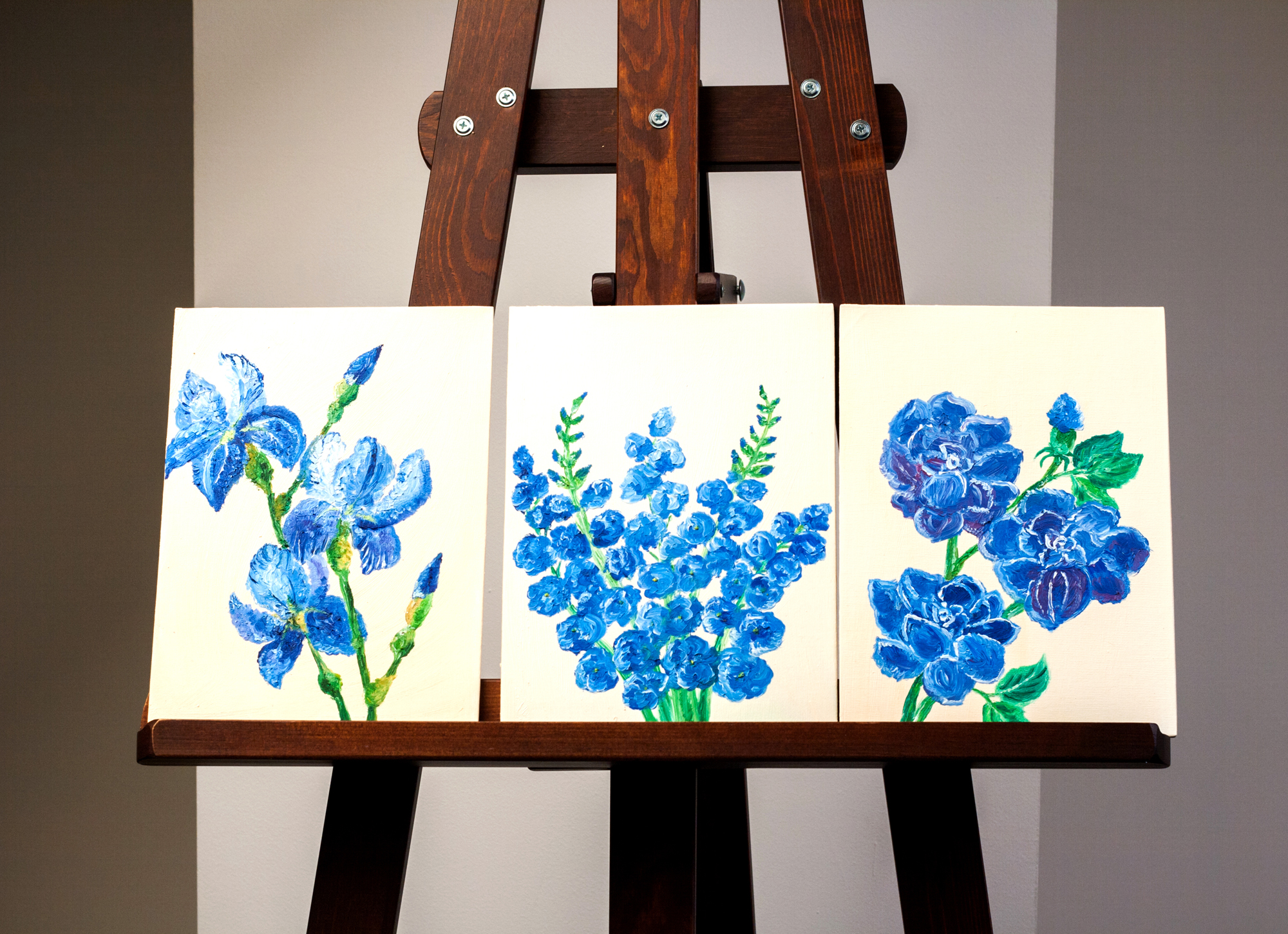 Three Separate Paintings of Blue Flowers